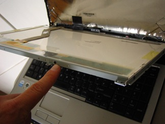 LCD panel coming away from the laptop case